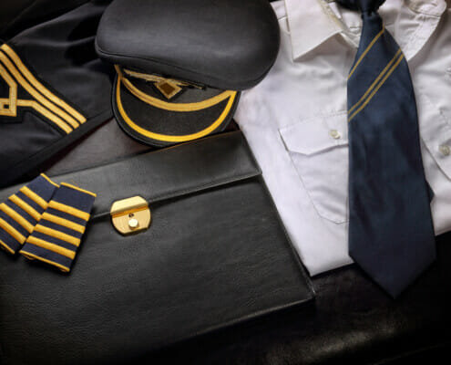 Why do airline pilots wear a uniform? What does the uniform consist of?